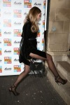 Abbey Clancy wearing black pantyhose