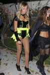 Ashley Tisdale wearing an halloween outfit